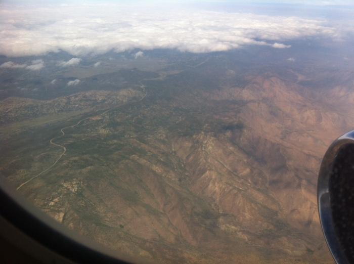 flying above the mountains headed to san diego
